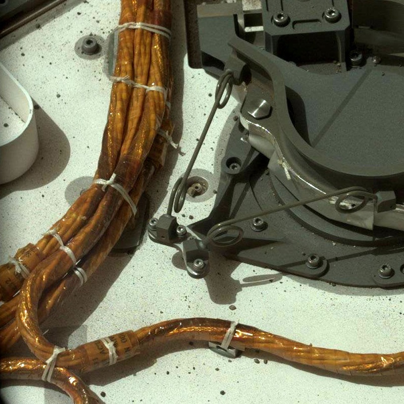 Spot ties affixing cable bundles to tie-down points
