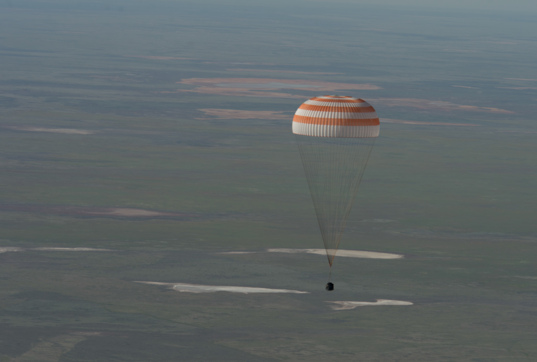 Soyuz sinks toward landing