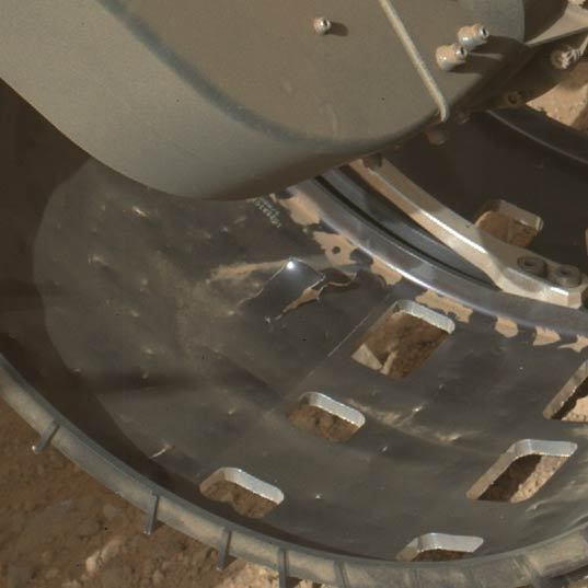 Detail view of Curiosity's left front wheel, sol 411 (October 2, 2013)