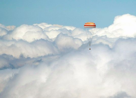 Soyuz TMA-12M descends through the clouds