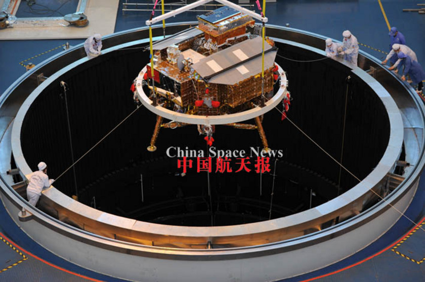 Chang'e-3 being lowered into chamber for thermal vacuum testing, May 2013 (tight view)