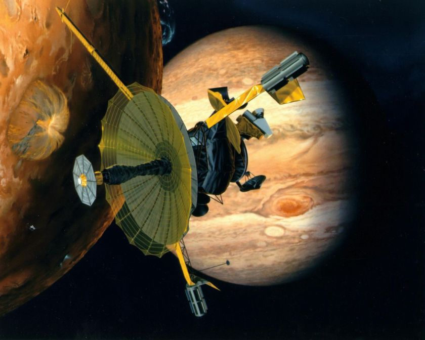 Artist's impression of NASA's Galileo spacecraft flying past Jupiter's volcanically active moon Io