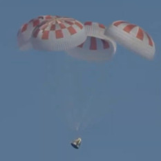 Crew Dragon Demo-1 under main parachutes