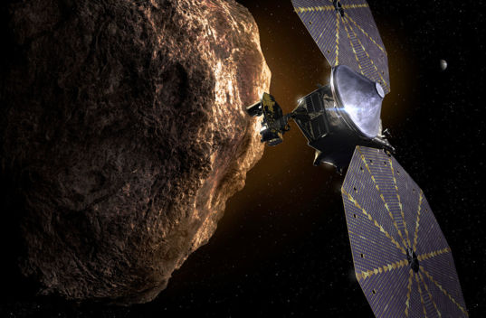 Artist concept of the Lucy spacecraft during one of its Trojan asteroid flybys.