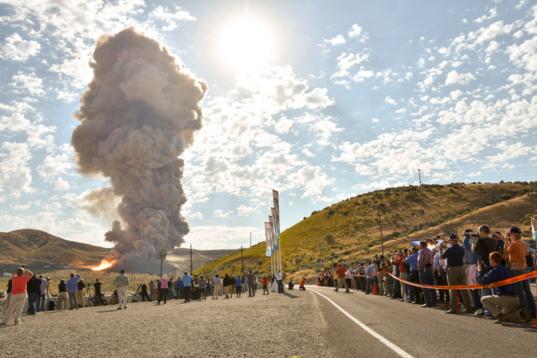 QM-2 booster smokes the hillside