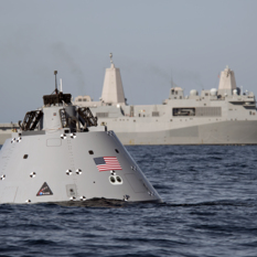 Simulated Orion crew module recovery