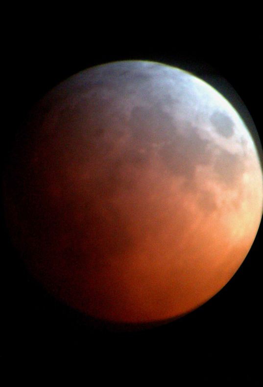 Lunar eclipse via iPhone behind a telescope