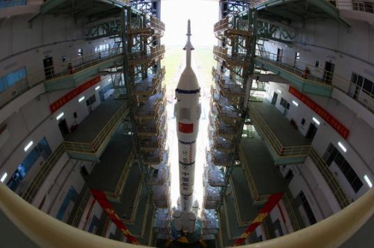 Shenzhou-9 rolls out