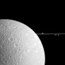 Dione in front of ringmoons