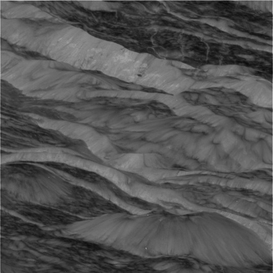 Dione's scarps and slopes