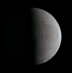 Half-phase Enceladus in color, 7 April 2010
