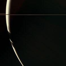 Nearly behind Saturn