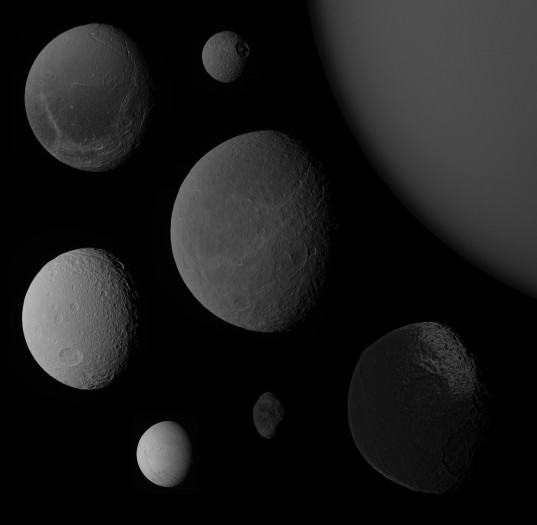 Saturn's moons at a common phase angle and a common scale