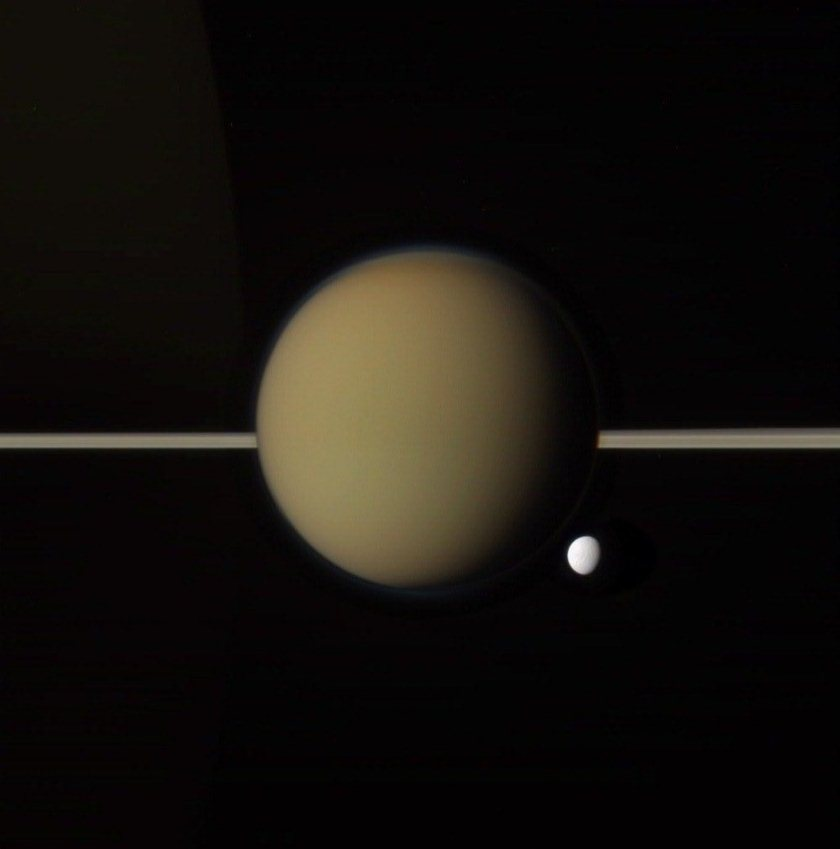 Titan, Tethys, rings, and ringlit Saturn