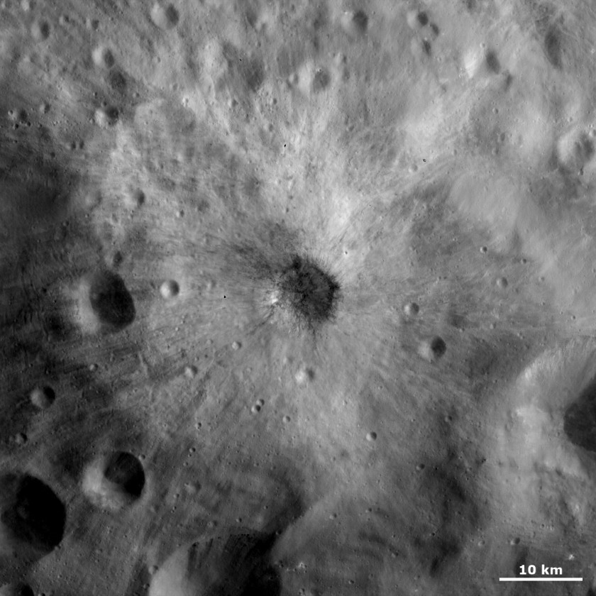Bright and dark ejecta in one Vesta crater