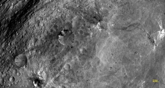 Black streaks in Vestian craters