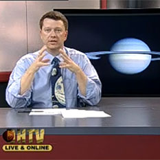 Bruce Betts screen shot teaching CSUDH Introductory Astronomy class with Saturn in background.