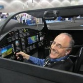 A happy Mat Kaplan in the XCOR Lynx cockpit's left seat at the Spacecraft Technology Expo, May 9, 2012.