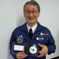 Jun'ichiro Kawaguchi with the IKAROS names disc
