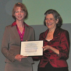 Melissa McGrath presents Emily Lakdawalla with the 2001 Eberhart Prize from the DPS, October 3, 2011