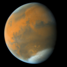 This photo of Mars was captured by the Hubble Space Telescope on May 9, 2003. Processed by Ted Stryk.