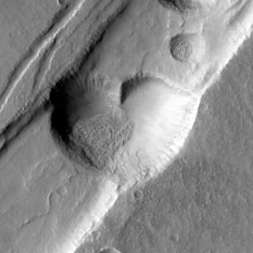 MRO CTX image of a heart-shaped pit on Mars in Acheron Catena, E flank of Alba Patera (detail view)
