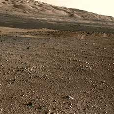 An attempt to colorize part of a Navcam image of the eastern flank of Aeolis Mons with the Mastcam thumbnail color panorama released on sol 3.