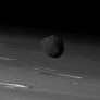 Phobos over Mars' limb from Mars Express