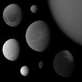 Dione, Mimas, Titan, Tethys, Rhea, Enceladus, Hyperion, and Iapetus, from Cassini science data, to a common scale and from similar phase angles, montage by Emily Lakdawalla