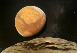Mars is seen from its outer moon, Deimos.