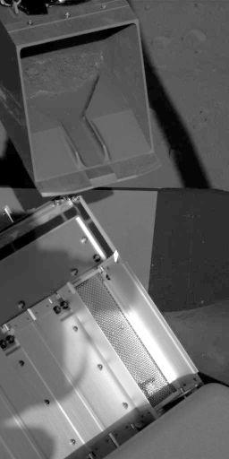 Robotic arm scoop poised over TEGA oven 0, sol 60