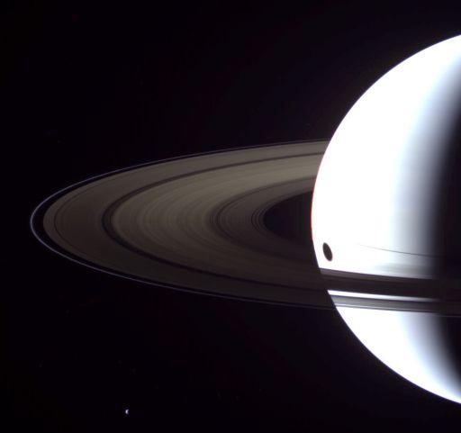 Saturn, Tethys, and Titan's shadow