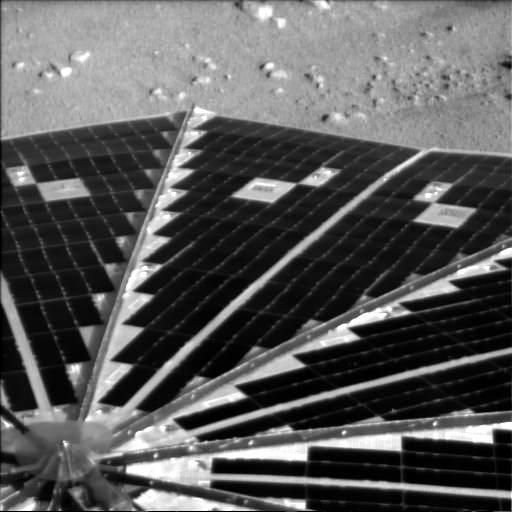 Phoeix solar panel against Martian soil