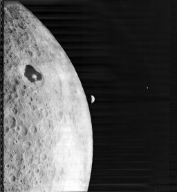 First image of Earthrise over the Moon