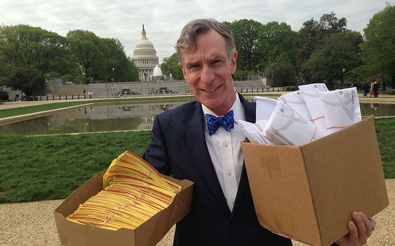 Bill Nye delivering petitions