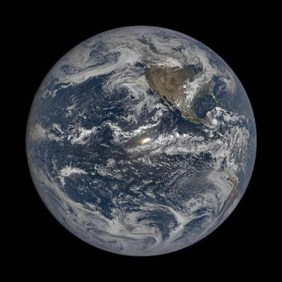 Sun glint ice particles earth
