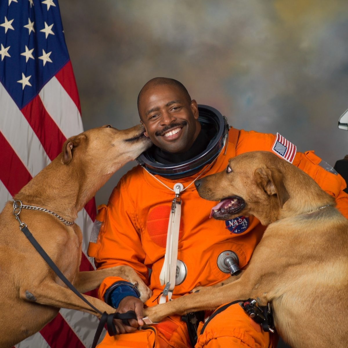 Leland melvin with dogs